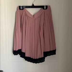 Pink and black pleated skirt